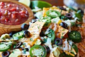 Nachos with cheese, jalapenos, black olives and salsa (Mexico)