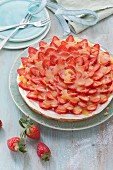 Sour cream cake with strawberries and an orange glaze