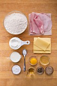 Ingredients for stuffed ham and cheese croissants made from quark oil dough