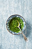 Homemade pesto in a small dish (top view)