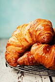Freshly baked croissants on rustic background