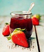 Homemade strawberry jam and fresh strawberries