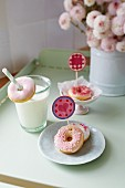 Mini doughnuts with heart decorations and a glass of milk