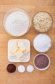 Ingredients for chocolate biscuits with almond flakes