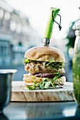 A burger with a knife in a bistro
