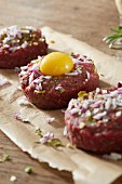 Beef tartare with onion and egg yolk