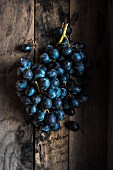 Red grapes in a wooden box