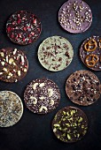 Vegan chocolate discs decorated with different toppings