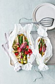 Mixed asparagus with red mullet in parchment paper