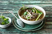 Asian noodle soup with asparagus and prime boiled beef