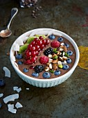 Chocolate and banana bowl with fresh berries and nuts