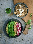 Springtime bowl with fried radishes and seed-covered mozzarella balls