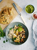 Mushroom and rice bowl with spinach pesto and tofu tortilla triangles