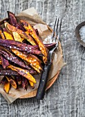 Colourful sweet potato chips with salt