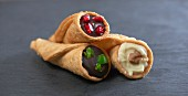 Filled tortilla cones with chilli chocolate, white chocolate with walnut and dark chocolate with pomegranate seeds (Mexico)
