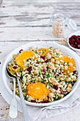 Quinoa salad with orange, chickpeas, cranberries and pine nuts