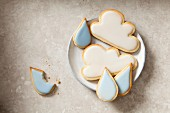 April: Cloud and raindrop cookies on a plate