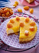 A mini cheesecake with kumquats