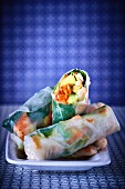 Rice paper rolls stuffed with prawns, avocado, carrots and mint