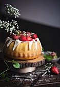 Cake with cream cheese glaze and strawberries