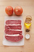Ingredients for rump steak with onions