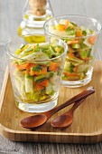 Carrot and apple salad in glasses with a curry and honey vinaigrette
