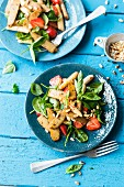 Vegan asparagus and strawberry salad with lupin fillets