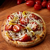 Small pizza with cherry tomatoes and peppers