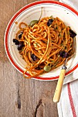 Noodles with tomato berserk, olives and capers (Italy)