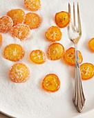 Sliced candied kumquats in sugar