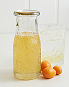 Kumquat syrup in a screw-top bottle
