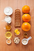 Ingredients for quark cakes with orange sauce
