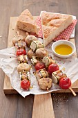 Feta and vegetable kebabs with flatbread