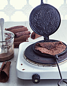 Chocolate pancakes in a waffle iron