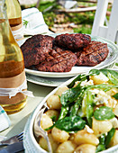 Grilled wild boar burgers with a chipotle glaze and potato salad