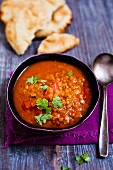 Red lentil soup with tomatoes and coriander