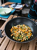 Wok-fried carrot and tofu with herbs