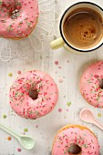 Pink doughnuts and coffee