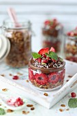 Cereal with chocolate and avocado mousse and raspberries in glass jars
