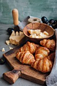 Croissants with hard cheese and grapes