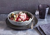 Vegetarian radish salad with pomegranate seeds and feta