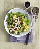 Celery and pineapple salad with poached chicken breast