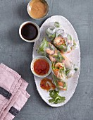 Vietnamese summer rolls with prawns and three different dips