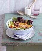 A sweet potato and avocado salad with radishes