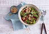 Chickpea and spinach salad with pine nuts