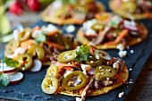 Tostadas topped with jalapenos