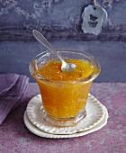 Bitter orange marmalade in a glass