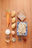 Ingredients for potato and carrot fritters with bean sprouts