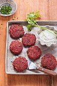 Vegetarian beetroot fritters with herb dip