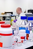 Reagent bottles on a laboratory shelf